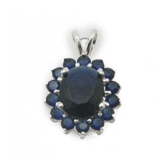 Ladies .925 Italian Sterling Silver fancy pendant with dark blue stone Length - 20mm Width - 13mm 1